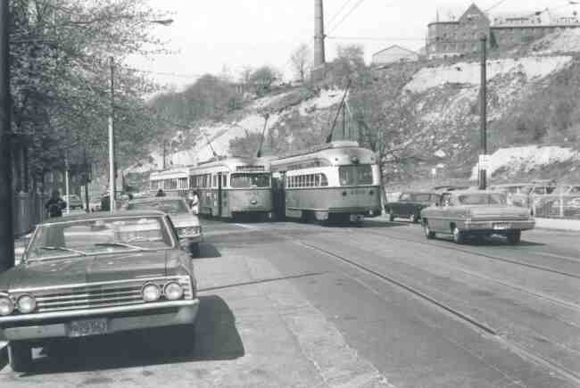 Trolley # 3047 & # 3210 converge in front of the Longwood Hospital on South Huntington Ave. in this 1969 photo. The New England Baptist Hospital can be seen high on the hill located on Parker Hill Street in Roxbury.
