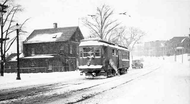 Trolley on wintry street run, 1965