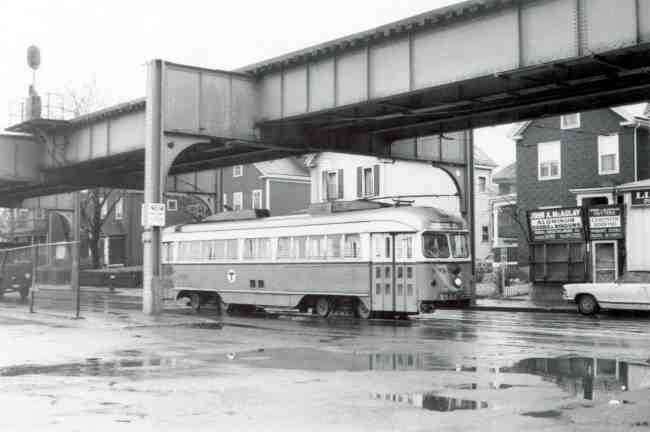 Trolley # 3327 travels up Washington Street on its way into the Arborway yard in this 1969 photo. McAulay Aluminum Doors and Windows storefront can be seen in the first floor of a converted house.