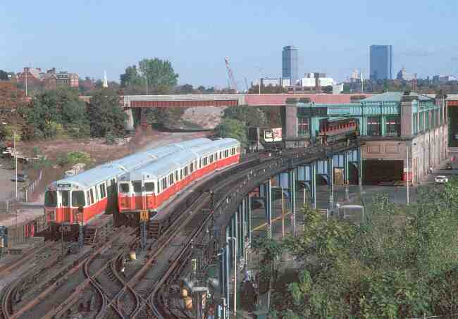 Twin Orange line trains can be seen berthed at the Forest Hills station in this 1983 photo.
