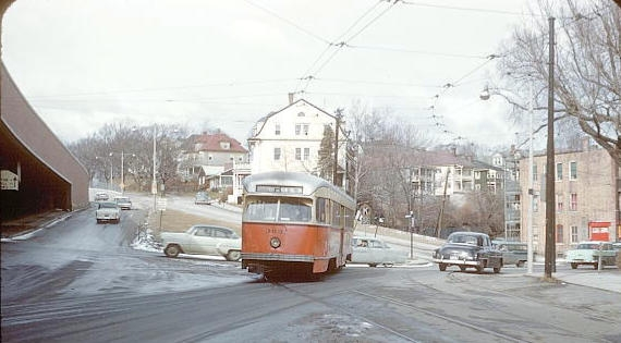 A trolley turning from South Street towards Forest Hills Station in 1960.
