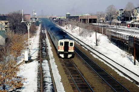 A New Haven Railroad train passes along Forest Hills Station in 1964.