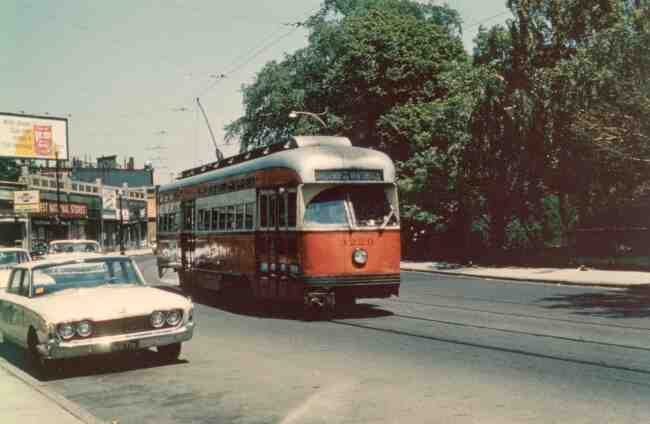 This 1964 South Street photo shows trolley # 3220 near the Monument on its way to the Arborway trolley yard. Note the First National Grocery Store in the block of buildings to the left.