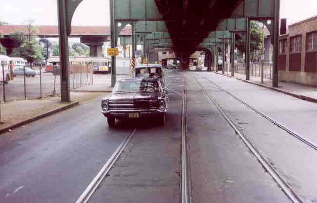 Washington Street near the Arborway MBTA yard seems almost deserted in this 1969 photo. The nice looking Ford Sedan with the number plate 55656 is being followed by a Boston Gas Company service van.