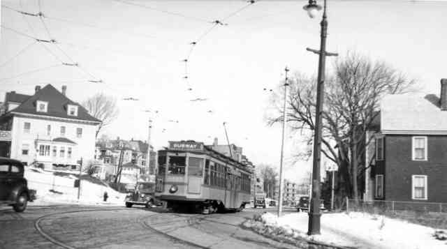Trolley # 6290 winds its way onto South Street at the Arborway on a trip towards Centre Street and beyond. Many old cars can be seen in this great old 1939 photo.