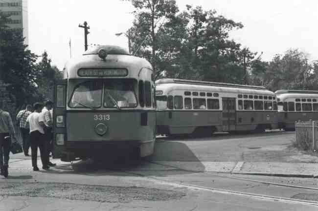 Trolley # 3313 is the lead car of this three-car convoy photo taken at the Heath Street Loop on South Huntington Ave. in 1968. A portion of the Jamaica Plain Veterans Hospital can be seen to the left of the photo.