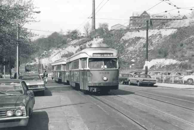 Trolley # 3065 travels on South Huntington Ave. near the Longwood Hospital in this 1969 photo. The New England Baptist Hospital on Parker Hill Street in Roxbury can be seen high on the hill.