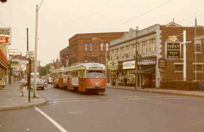 Trolley # 3046 is heading towards Park Street in this 1970 photo on Centre Street at the corner of Seaverns Ave. Some of the thriving businesses shown are the First National Bank, Jones Camera Shop, Helen's Donut Shop, The Edison Store, Hanlon Shoes, F. W. Woolworth, Hailer's Drug Store, Karsh Jewelers, Harry's Hardware, and the Publix Market.