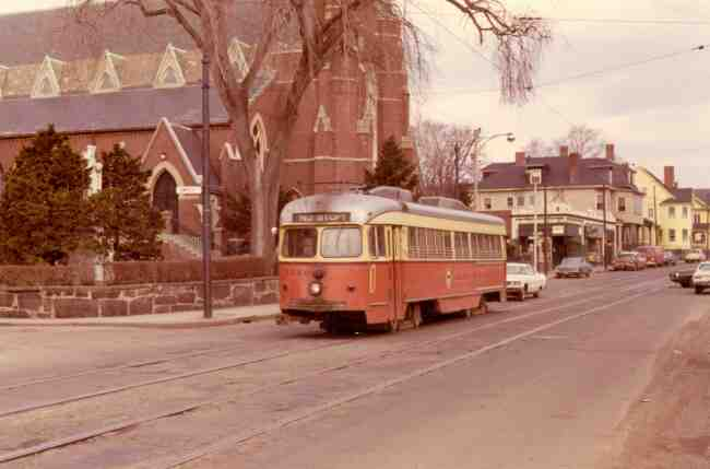 Trolley # 3326 can be seen traveling between Saint Joseph St. and Jamaica St. in front of Saint Thomas Aquinas Church in this 1971 photo.