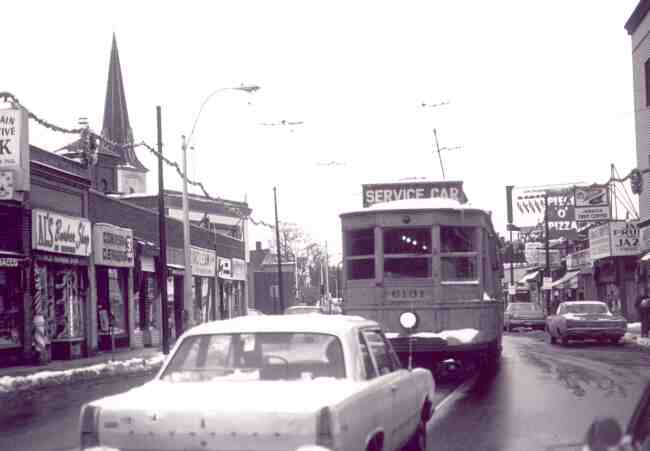 Service car # 6131 clears the tracks on Centre Street at Seaverns Ave. in this 1960's photo. The Christmas decorations can be seen strung overhead in the business district.