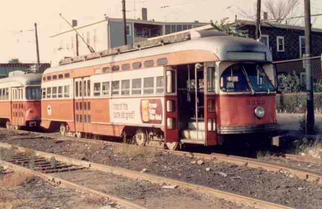 Trolley # 3220 sits vacant at the Arborway yard on Washington St. in this 1968 photo. The ad on the side of the trolley is for Victor Coffee.