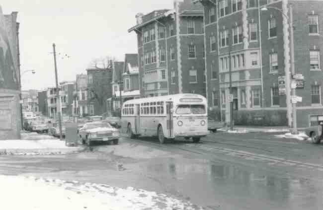 Bus # 2119 is heading towards Wren Street in Roslindale as shown in this 1971 photo taken on South Street near Mark Street and the Arborway.