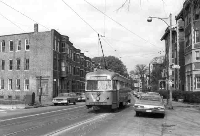 Brick apartment buildings can be seen on either side of South Street as trolley # 3326 passes St. Mark Street on its way towards Park Street station in this 1960s photo.