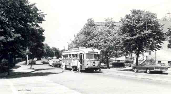 Trolley # 3324 can be seen picking up passengers on a nicely tree-lined section of South Huntington Avenue at Bynner Street in this 1971 photo.