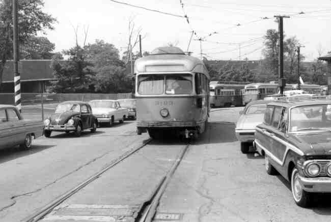 Trolley # 3103 rests idly along side the Arborway MBTA office in this late 1960s photo.