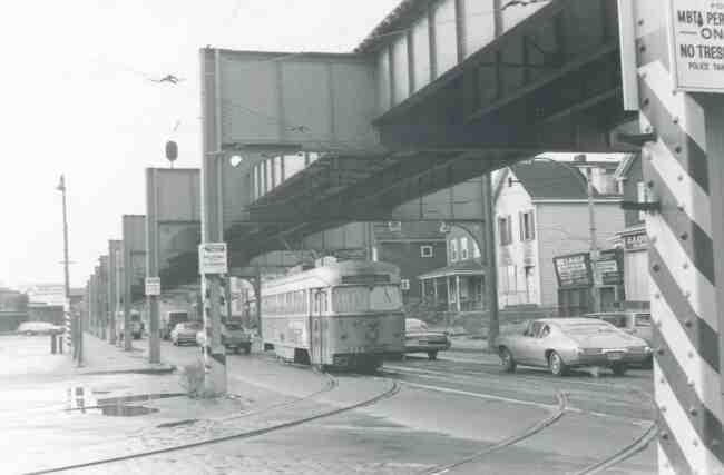 Trolley # 3323 begins its entrance into the Arborway trolley yard in this 1969 photo taken on Washington Street. One of the businesses that can be seen is John McAulay Aluminum Doors and Windows.