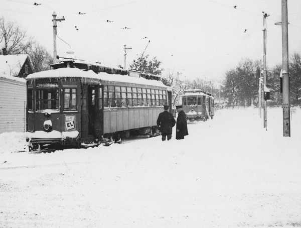 A type 4 semi-convertible and a plow at Charles River Loop (now 36 bus) 1937.