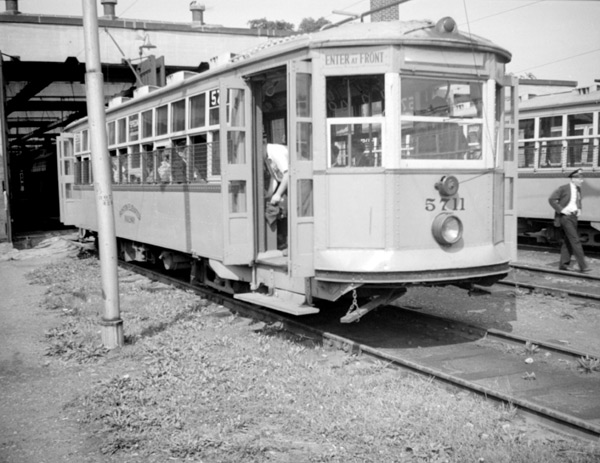 5711, seen in front of the Arborway carhouse is a 'Type 5'; a very light, but large car which saw heavy use all over the system. There were 471 of these cars and they are among the most often restored of all custom-made American streetcars. There is a 'Type 5' currently resident in Boylston Station. That car originally did its tour of duty on the Arborway line. November 7, 1941.