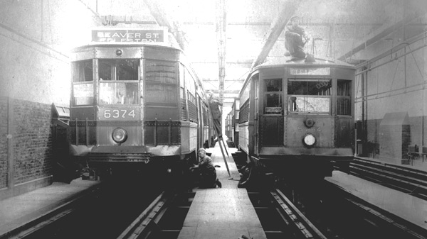 Two cars in the Jamaica Plain maintenance and repair facility. The car on the left served the Seaver Street Humbolt line providing service to Dudley Square and to Dorchester via Roxbury.