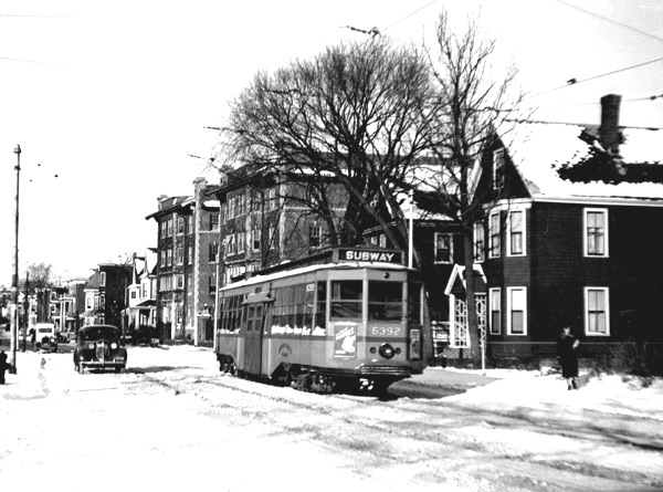 Car 6392, seen in November of 1938 at the point where the Arborway line turned onto the reservation and headed under the railroad into the Arborway yard. This type of car had a low center entrance that made it easy to climb up into to, but of limited use as subway car since the door was too low for the platform. When they were retired from passenger service, many stayed on and saw duty as sand or salt cars.