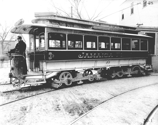 This open-end car and engineer pose in front of the Forest Hills carhouse (which would later become the Jamaica Loop) about 1896. By 1905, all cars were enclosed. An enlargement showing a better view of the conductor is shown on the next page.