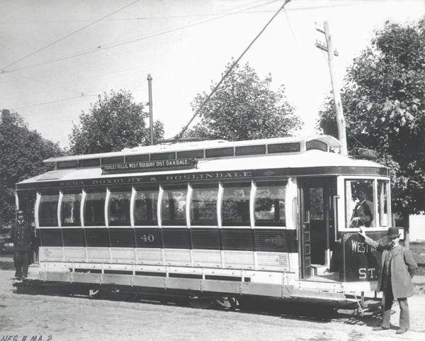The Barrerel Car #40 serving West Roxbury and Roslindale shown here previously although with a different crew ca. 1897. This type of car was designed to be completely open in the summer and closed in the winter.