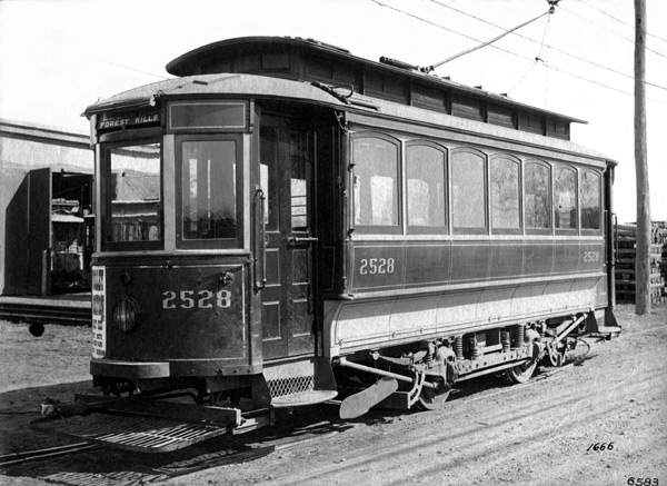 This East Walpole car operated on the Old Colony St. Railroad and would normally be stored in Westwood. In this view, ca. 1897, the car is shown far from home in the yard of the Forest Hills carhouse. It was likely being stored here during off-peak hours due to shortage of parking spaces in Westwood.