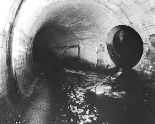 A portion of the system of tunnels that carry the Stony Brook from its origin in the Stonybrook  Reservation in West Roxbury to the point where it empties into the Charles River. This undated photograph was taken under Amory Street in Jamaica Plain and is provided courtesy of the Boston Water and Sewer Commission.