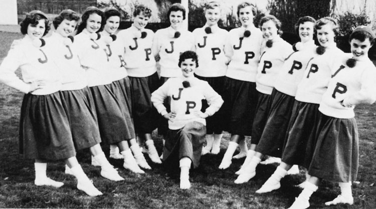 Cheerleaders of the Jamaica Plain High School in 1956 were, from left to right: Barbara Spinney, Catherine Gotovitch, Mary Parlon, Claire Boyce, Lorraine Dustin, Ann Kearns, Ann Litch, Beatrice Canny, Betty Ann Fetler, Joyce Mutlow, Gwenneth Edwards, Mary Jo McLaughlin, and Marilyn Guiva (kneeling in the center). Photograph courtesy of the Boston Public Library.