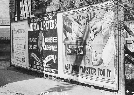 A billboard at Green and Washington Streets. At the center is a campaign poster for Andrew J. Peters for Congress. To the right is an advertisement for Sterling Ale. This photograph is an enlarged view of a portion of another photograph appearing on this site. Photograph courtesy of David Rooney.