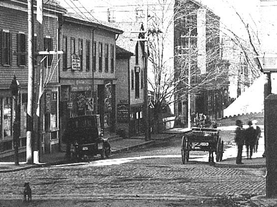 A 1906 view looking down Green St. towards Amory St. Washington St. crosses in the foreground. Current addresses shown in this view run from 171 to 209 Green St.