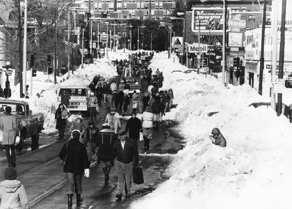 Jamaica Plain residents begin to venture out of their homes after a single lane of traffic is cleared of snow in February, 1978. This view is from Green Steet looking towards Boston. Photograph taken by and provided courtesy of Mark Hoffman.