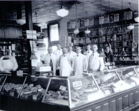 Employees of Patterson's Market on South St.  John W. Patterson stands next to the scale. George Porter is shown second from right and Josepth Patterson third from the right. Photograph provided courtesy of the Patterson family.  A higher resolution version of this image is  available .
