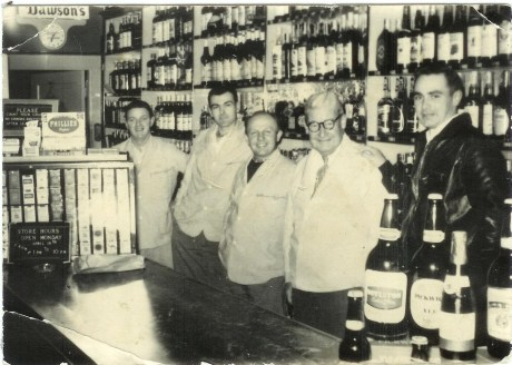 Employees of Patterson's Liquor Store, from left to right:  John Riley, Steve McCauley, Vinnie Boris, Ted Patterson, and John Patterson. Photograph courtesy of the Patterson family. A higher resolution version of this photograph is  available .