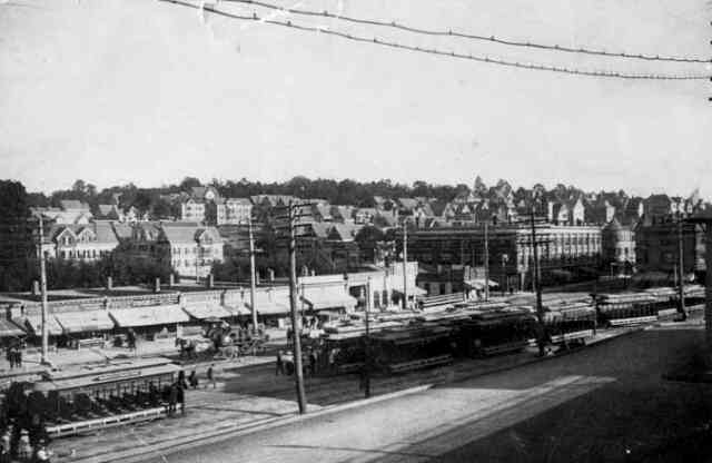 Open trolley cars, used exclusively during the summer months, fill a siding along Washington St. at Forest Hills circa 1900.