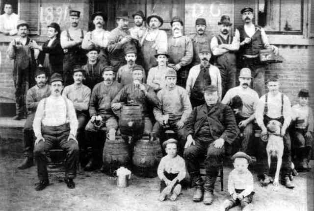 Workers at the Haffenreffer brewery pose outside the plant along with some of their children and a pet in this 1891 photograph. Courtesy of the Boston Public Library.