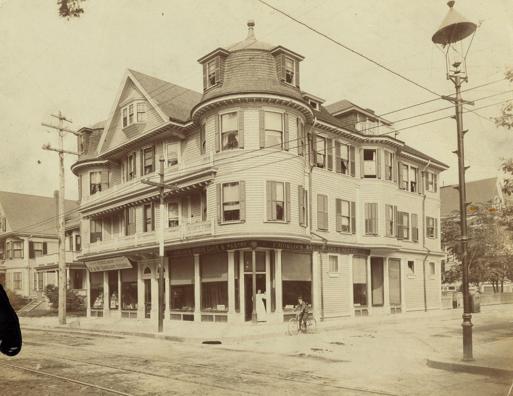 Frederick Morlock (1850-1906), born in Germany and naturalized in 1881, owned the large building at 416 Centre Street and the smaller house next to it at 408 Centre Street. He owned and operated the bakery in the corner store pictured here where El Oriental de Cuba is currently located. The photograph was taken around 1905. The woman in the doorway is believed to be Margaretha (Gretchen) Maylandt Morlock (1877-1914). Photograph provided courtesy of Kathy Griffin.
