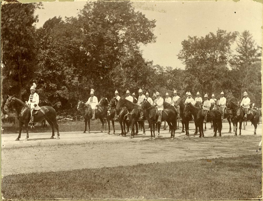 Members of a fraternal organization parade through the Arnold Arboretum on horseback. July 4, 1898. Courtesy of Greg French.