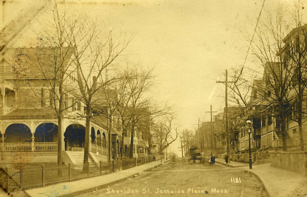 Sheridan Street as viewed from Centre Street. Note the horse drawn wagon, children and gas lights. Courtesy of Greg French.