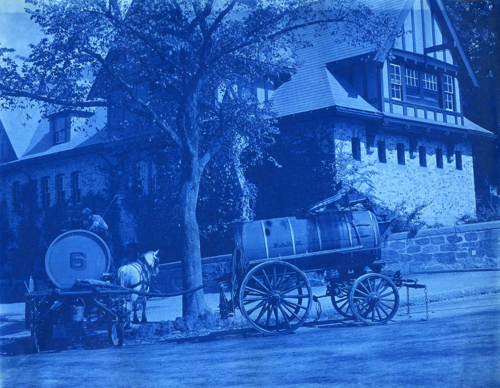 A cyanotype showing two horse-drawn oil sprinkler carts at the corner of the Jamaicaway and Perkins Sts. September 26, 1906. Courtesy Greg French.