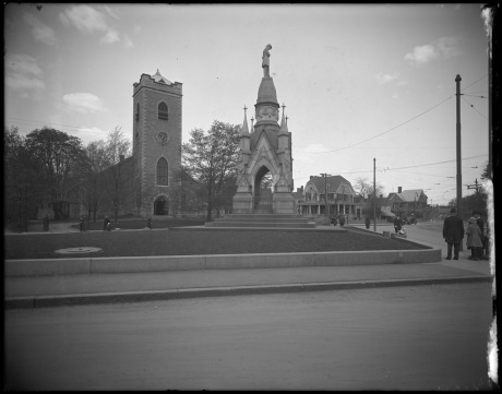 Soldier's monument and First Congregational Church Society, Eliot Street  and South Street. May, 1920 .   Photograph by Leon H. Abdalian, courtesty Boston  Public Library.