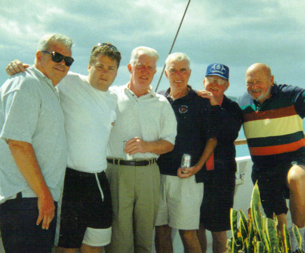 Some of the old gang, and one youngster, on a cruise, 1997. From left to right, Bob Teehan, Tim O'Connor, John Tighe, Fran Tighe, Pat Doherty, and Bob Power.