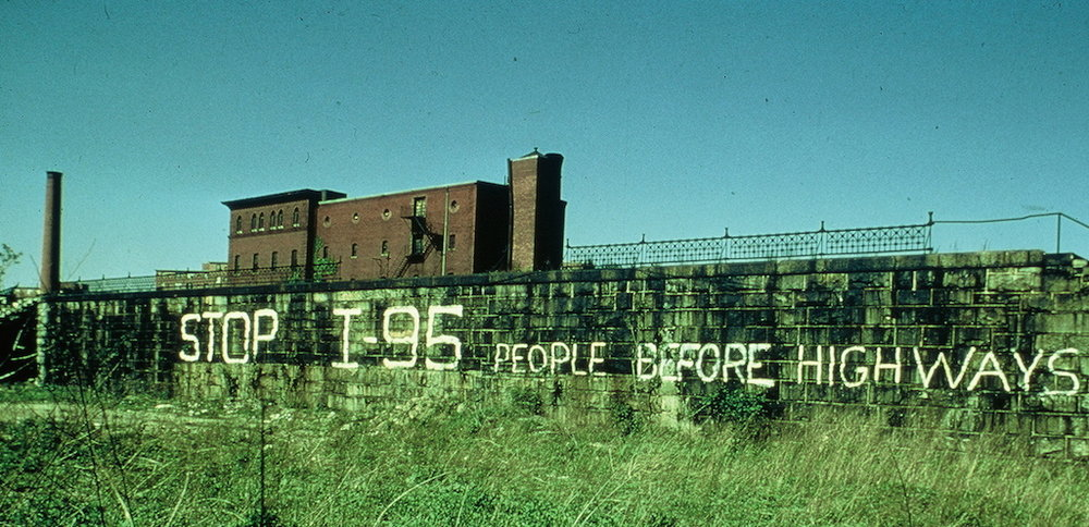 Graffiti reading 'Stop I-95: People Before Highways'