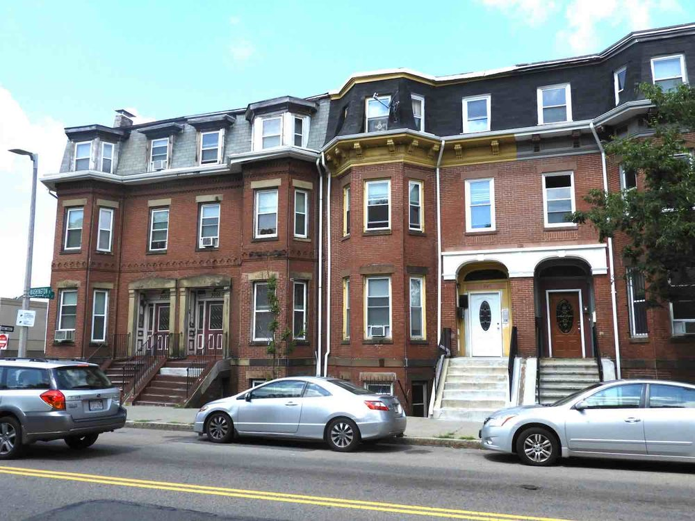 Detail of 2991-3003 Washington Street built by George Allen about 1872- 1873. A series of four, three –story, double townhouses with mansard roofs.  The first housing developed easterly of Egleston towards Dudley Square, the South End-style row house never caught on in Egleston Square.