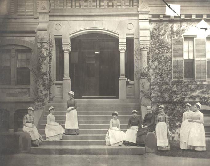 Group of nine caregivers outside the Adams-Nervine-Asylum in Jamaica Plain, West Roxbury, Massachusetts. Courtesy Historic New England.