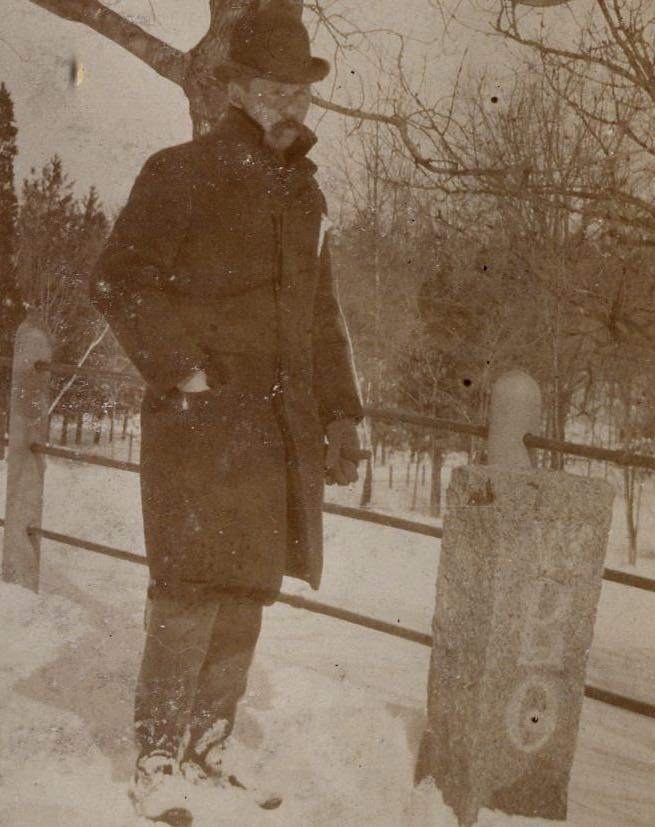 Man standing by boundry marker. Photograph provided courtesy of City of Boston Archives