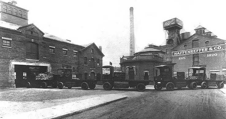 Delivery trucks line up to load beer in this undated photograph of the Haffenreffer brewery. https://en.wikipedia.org/wiki/Haffenreffer_Brewery