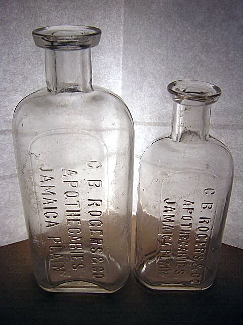 The C.B. Rogers bottles shown here were made by the Whitall Tatum glass factory in Millville, New Jersey which was one of the first glass factories in America. They were in business from 1806 to 1938 making glass jars, vials and embossed prescription bottles for pharmacies all over America. The embossed (raised) lettering on the bottles was formed using cast iron molds shown below. Three of the C. B. Rogers bottle molds that were used at the Whitall Tatum factory are shown. These iron molds were formed in several sizes to emboss the various prescription bottle sizes that Rogers used.