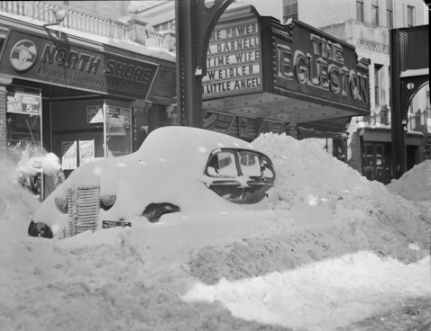 Car in the snow, outside The Egleston movie house (courtesy Boston Public Library)