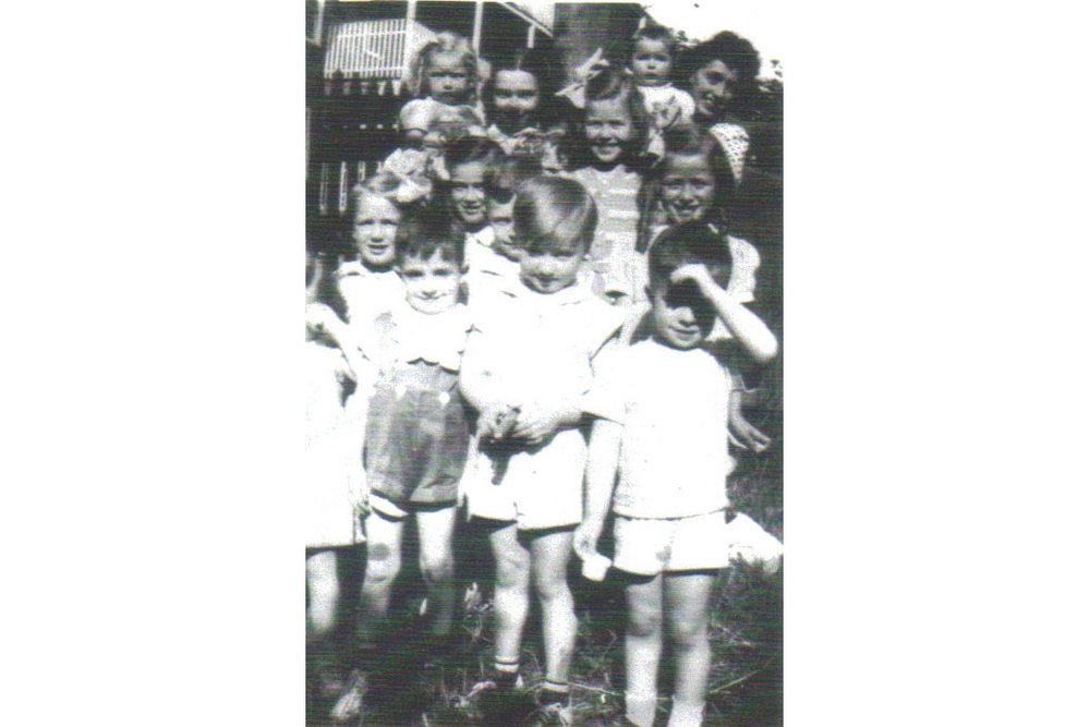 Backyard party Montebello Road 1940. First row left to right, Helen Cradock, Pauly Connaughton, Bobby Power, and Billy Connaughton. Second row, left to right, Mary Cradock, Joan Power, and Patsy Cradock. Back row, left to right, Catherine Coffey holding Chris Cradock and Marie Power holding baby.